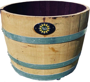 Self watering Half wine barrel on wheels.