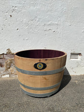 Load image into Gallery viewer, Self watering Half wine barrel on wheels.