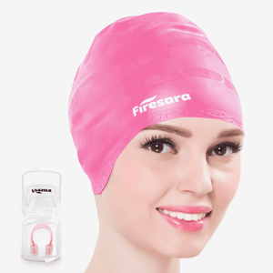 side view of female model wearing pink hair cap for swimming