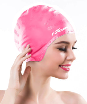 severe side view of model wearing pink swim cap for long hair