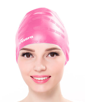 front view of female model wearing pink hair cap for swimming