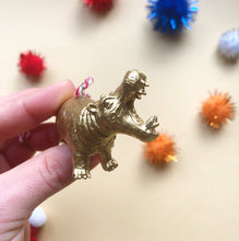Load image into Gallery viewer, Hippo Eating Santa Hat Bauble in Gold