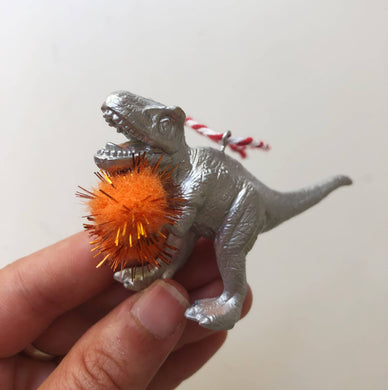 Mini T Rex Holding Pom Pom Bauble in Silver
