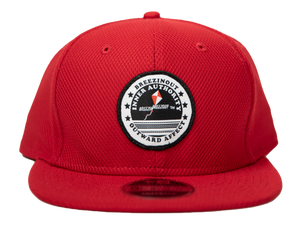 Red snap back baseball cap with IAOA seal center front
