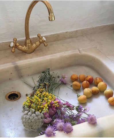 Flowers and fruits in the sink