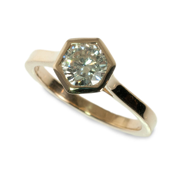 Hexagonal bezel set diamond engagement ring