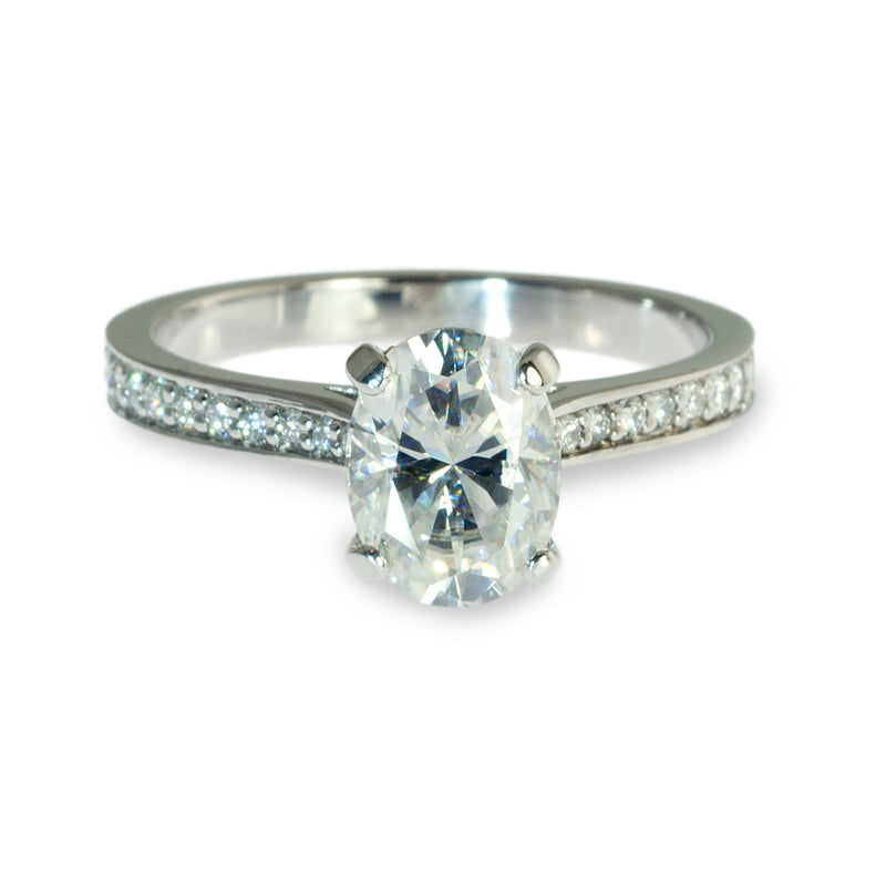 Oval center hidden halo engagement ring