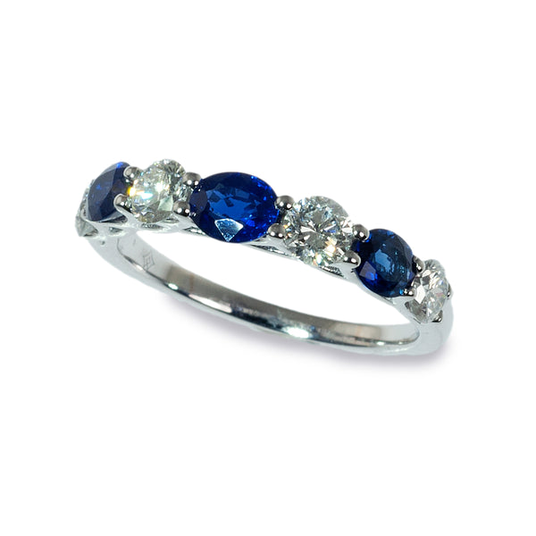 Oval sapphire and diamond band ring