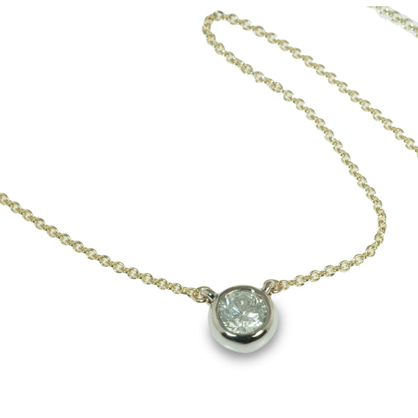 Two-tone bezel set diamond pendant