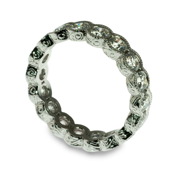 Semi bezel diamond eternity ring