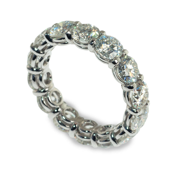 Moissanite shared prong eternity ring