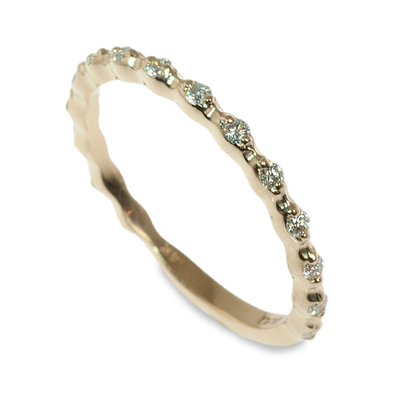 Delicate spaced diamond band