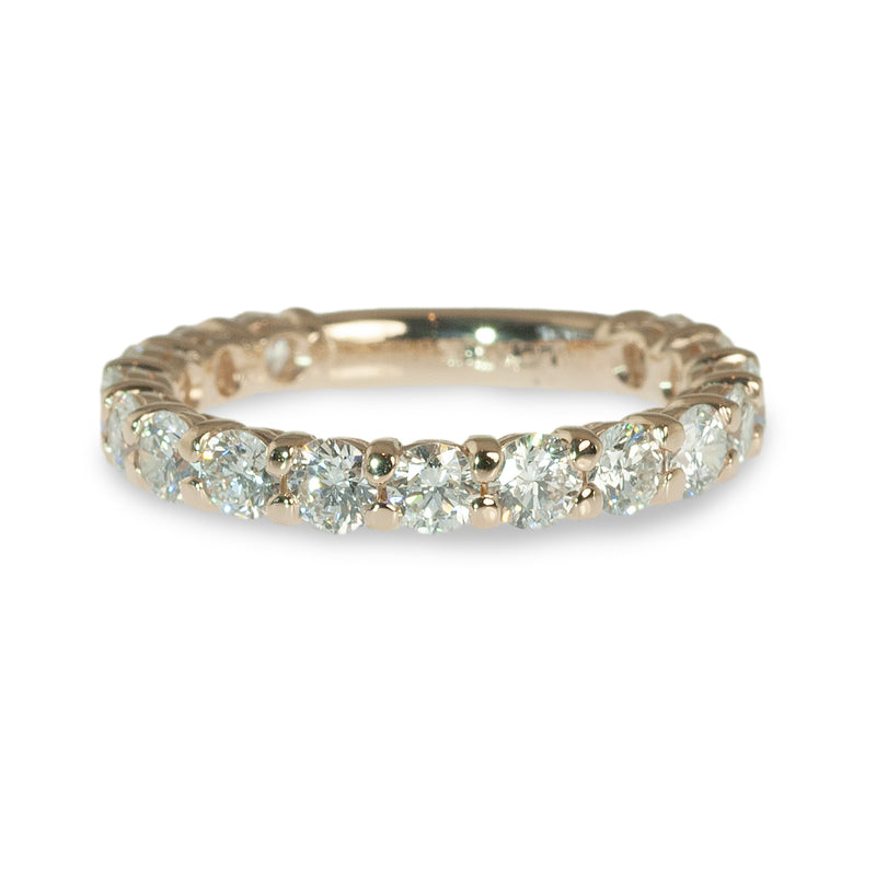 Traditional shared prong diamond ring
