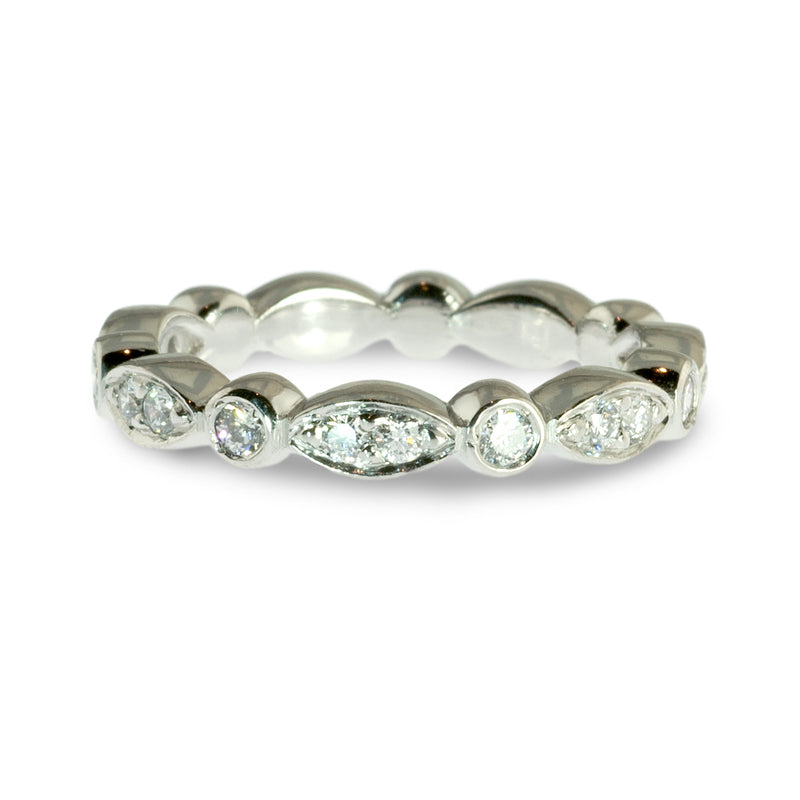 Marquise shaped and round bezel diamond wedding ring