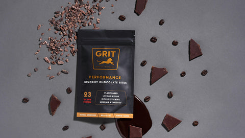 GRIT Superfoods Performance Chocolate Bites on grey background with Chocolate