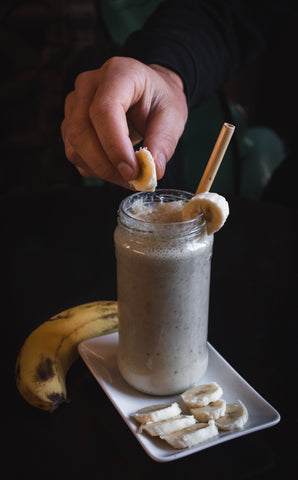 Chocolate smoothie with chopped bananas on plate