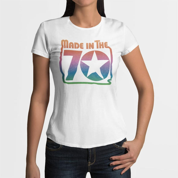 Women wearing white a t-shirt with a bold 'Made in the 70's' rainbow gradient colour retro star graphic.