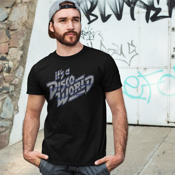 Cool guy wearing a black t-shirt with 'it's a Disco World' silver graphic retro design print.