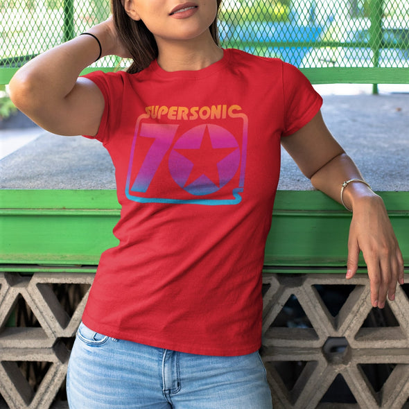 Young women wearing red t-shirt with a bold 'Supersonic 70's' retro style print in rainbow gradient colours.