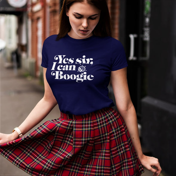 Women in tartan skirt dancing in street with a vay t-shirt and 'Yes Sir i can boogie' white slogan print.