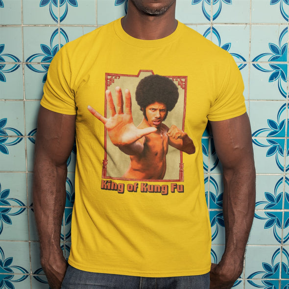 Afro Karate vintage style  Graphic 'King of Kung Fu' Yellow T-Shirt modelled by a muscular man.