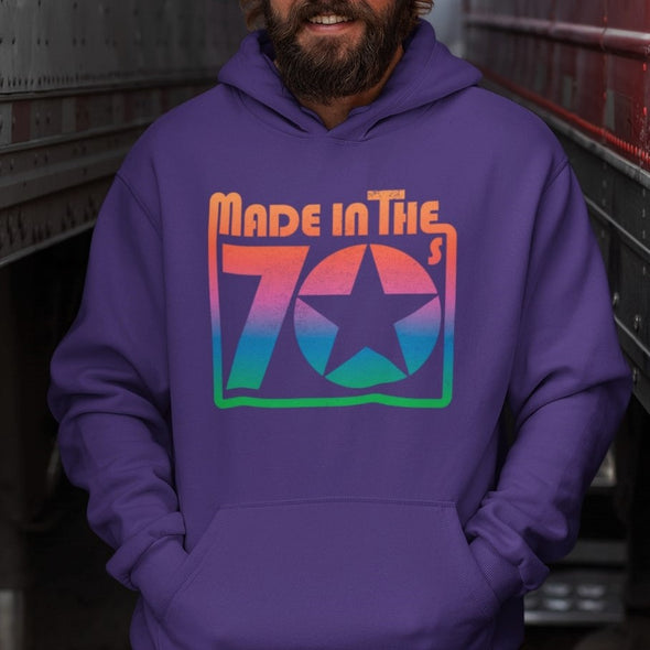 Bearded Model wears Purple Hoodie with Retro Style 'Made in the 70's' Graphic printed on chest in Rainbow Tones