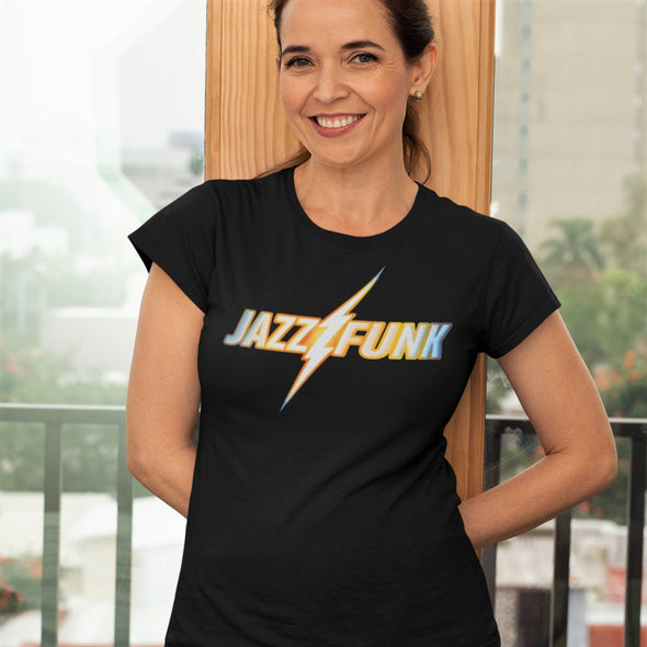 Smiling women leaning against a window in a black t-shirt with a 'Jazz Funk' retro design print in gradient colours.