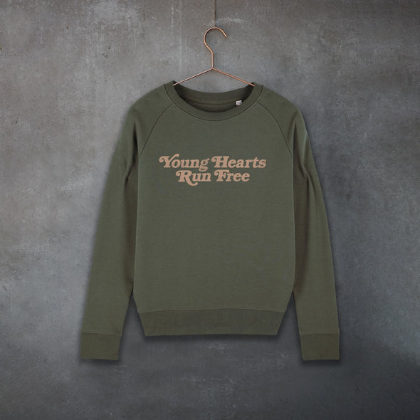 Khaki Raglan Sweatshirt with Retro-Style Slogan 'Young Hearts Run Free' Printed in earthy rust colour.