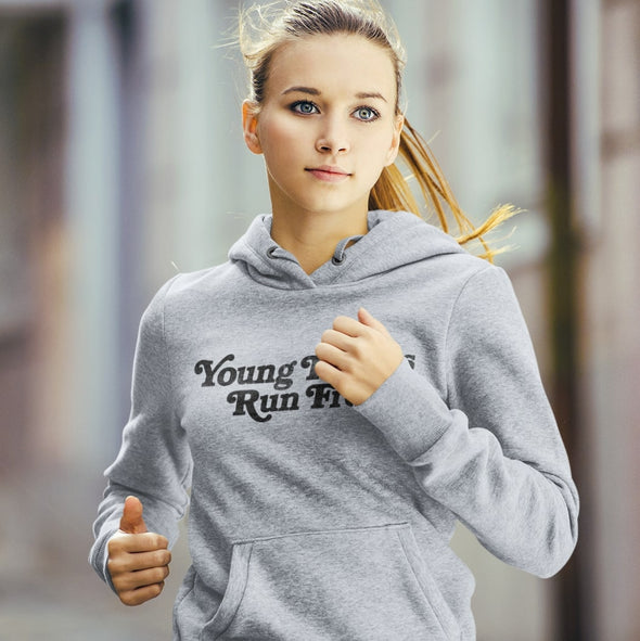 Running Woman wears Classic Grey Marl Hoodie with Retro-Style text 'Young Hearts Run Free' printed on chest in black