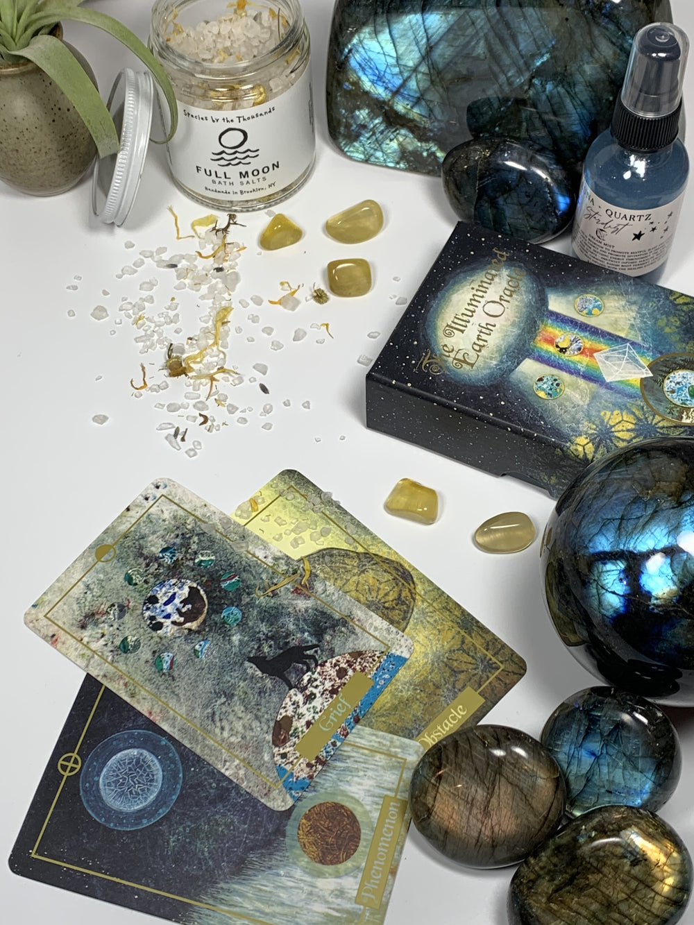 Illuminated Earth Oracle with high flash labradorite crystals, palm stones, spheres, bath salts and Luna and Quartz Stardust spray