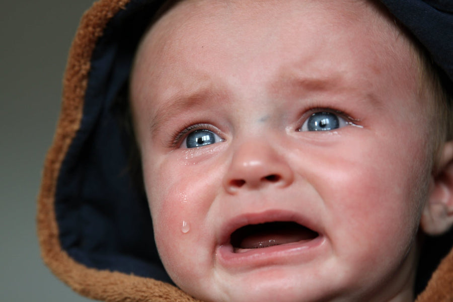 TOP 10 REASONS WHY BABIES CRY & HOW TO CALM THEM