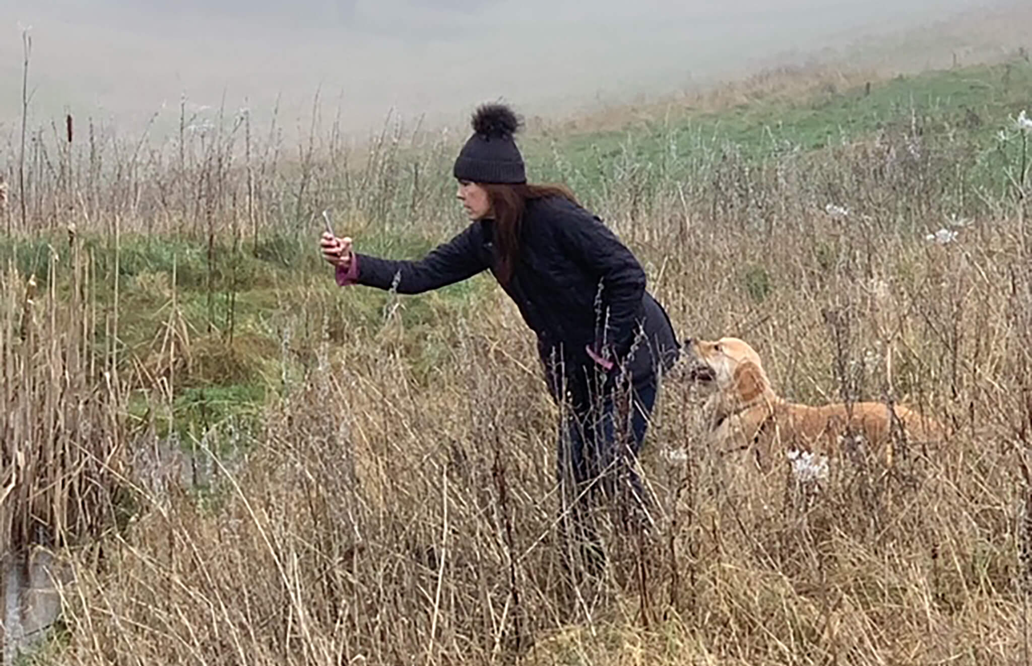 Amanda Gosse and Teddy the golden retriever photographing local wildlife for art reference