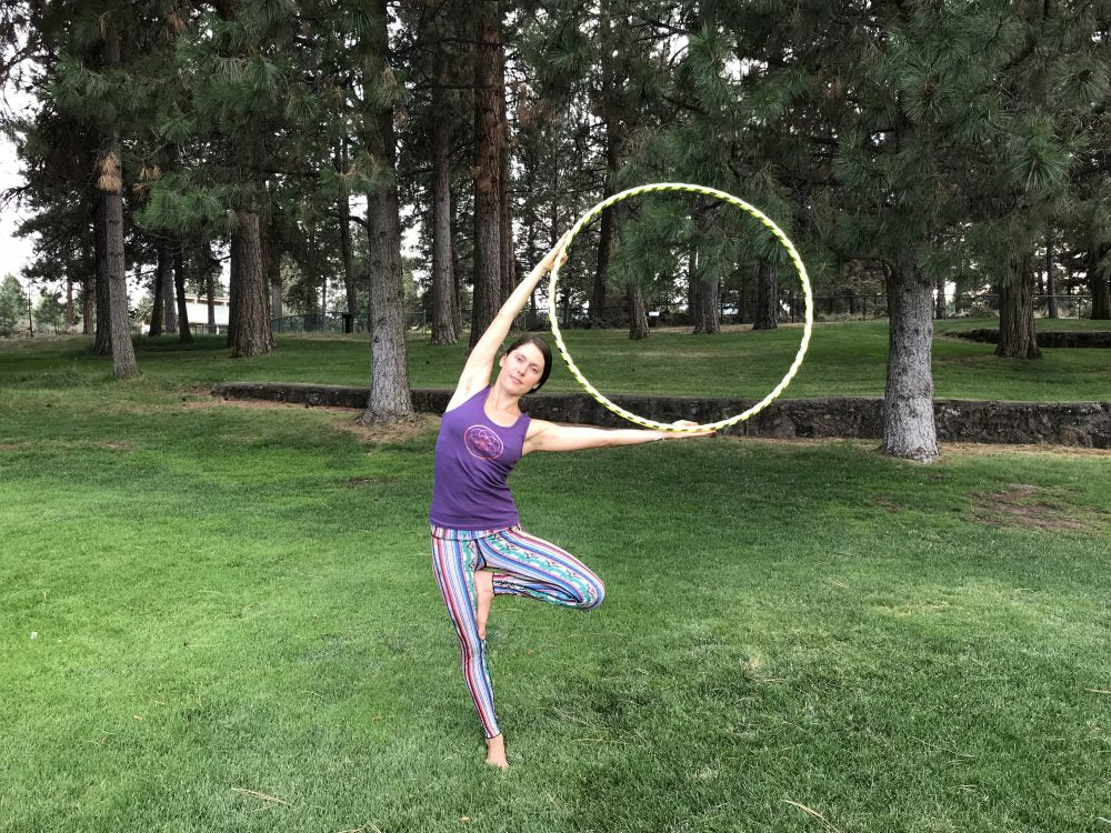 tree pose with hula hoop