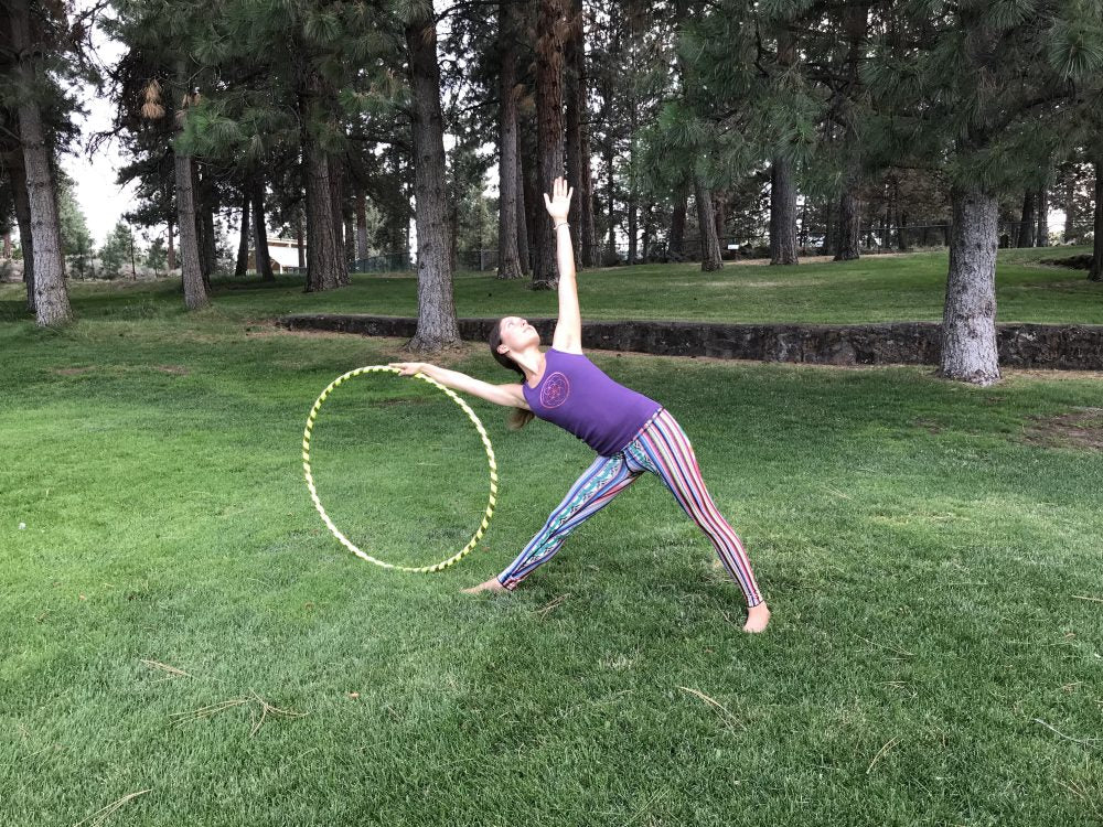 triangle pose with hula hoop