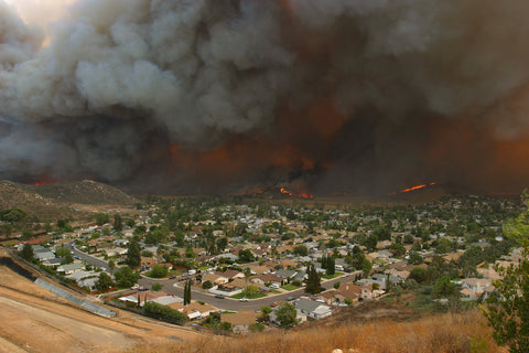 A wildfire burning toward homes.
