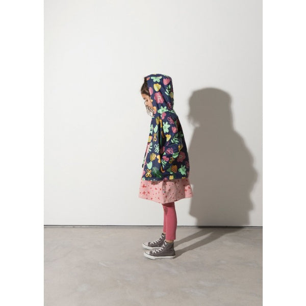 a girl wears the Minti winter foliage waterproof girls raincoat with warm cotton lining
