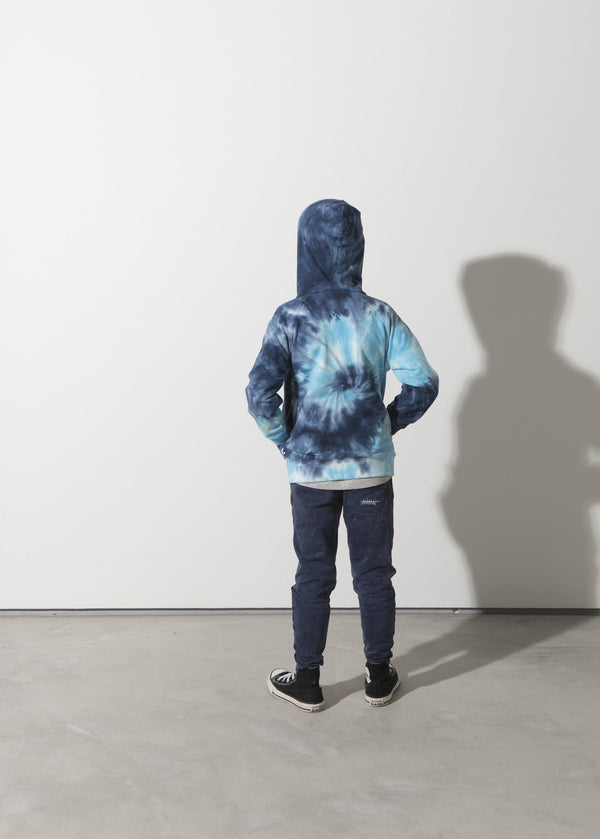 a boy faces the back showing the back print on the Minti long sleeve spiral furry cotton fleece hoodie in blue