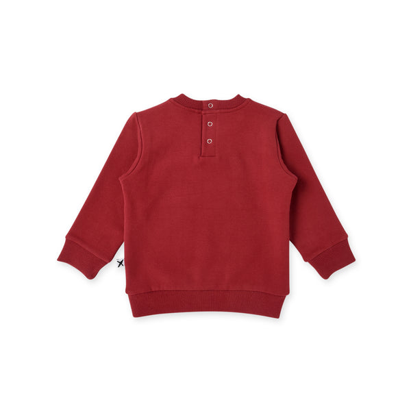 the back view of the minti my name is awesome long sleeve baby jumper in rusty red MNT626-W20-F-MN-RR