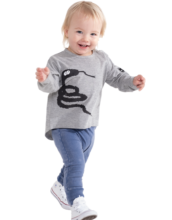 a baby wears the band of boys organic baby t-shirt with furry snake print n grey organic GOTS certified cotton