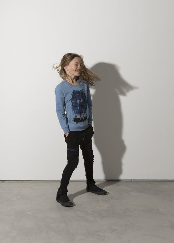 a girl wears the minti messy skater blue crew jumper in cotton with inner fleece MNT893-W20-F-MS-MB