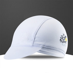 a white baseball hat sitting on top of a white surface