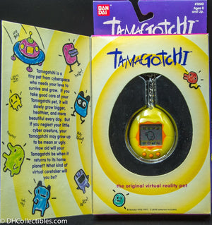 1996 Bandai Virtual Pet Handheld System Tamagotchi Yellow with Orange