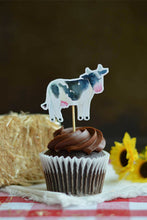 Load image into Gallery viewer, Cow cupcake topper on a chocolate cupcake from our farm party theme