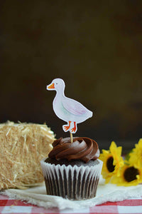 White duck cupcake topper on a chocolate cupcake from our farm party theme