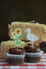 Load image into Gallery viewer, Sunflower and Duck cupcake toppers on a chocolate cupcake from our farm party theme