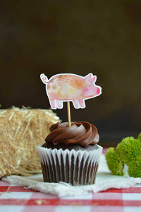 Pig cupcake topper on a chocolate cupcake from our farm party theme