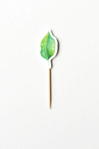 Green leaf cupcake topper from wild jungle party theme