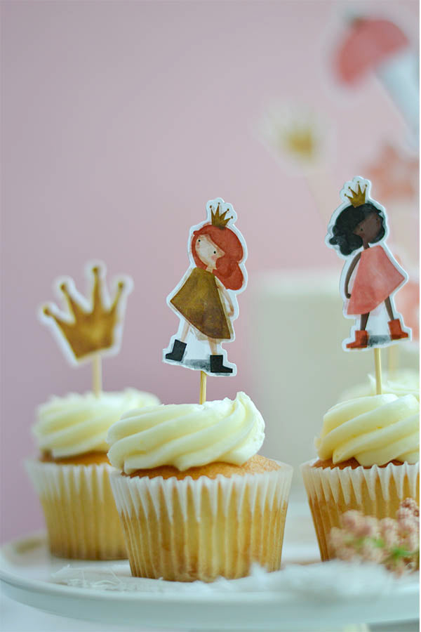 Red hair and brunette princesses cupcake toppers on top of vanilla birthday cupcakes