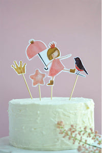 From Princesses Party Theme, Cake Toppers including princess, crown, pink star and bird on a birthday cake