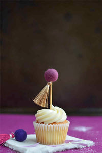 Purple Pom Pom Cupcake Topper on a vanilla cupcake